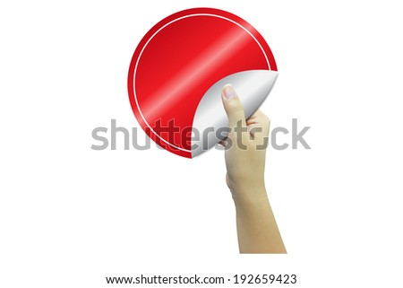 hand holding circle of red paper with space for your copy. - stock photo