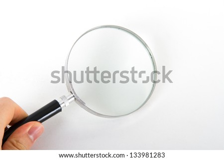 Hand holding classic style magnifying glass, isolated on white background. - stock photo