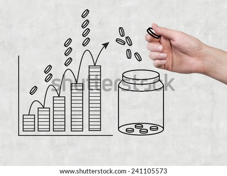 hand holding coin and drawing coin chart - stock photo