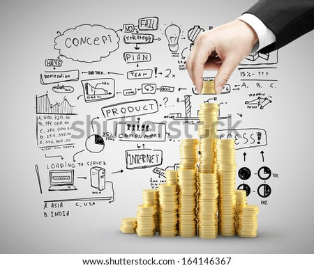 hand holding coins chart, business concept - stock photo