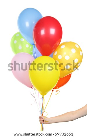 Hand holding colorful helium balloons isolated on white background - stock photo
