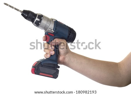Hand holding Cordless power drill - stock photo