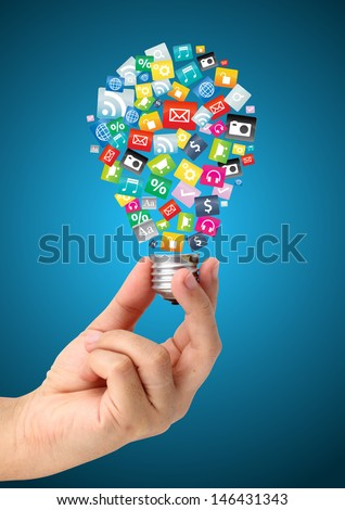 Hand holding creative idea with cloud of colorful application icon, Business software and social media networking service concept - stock photo