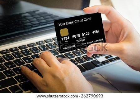 Hand Holding Credit Card Over Laptop Online Shopping Concept - stock photo