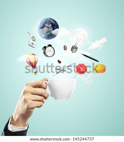 hand holding cup, travel concept - stock photo