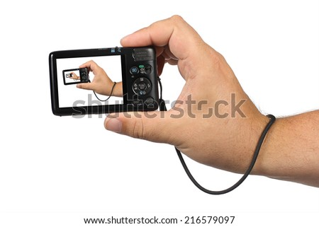 Hand holding digital camera with a repeating image on a white background - stock photo