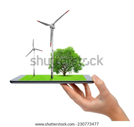 Hand holding digital tablet with a wind turbines and tree . Green energy concept.  - stock photo