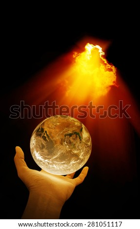 Hand holding earth and light beam , concept design , Elements of image are furnished by NASA - stock photo