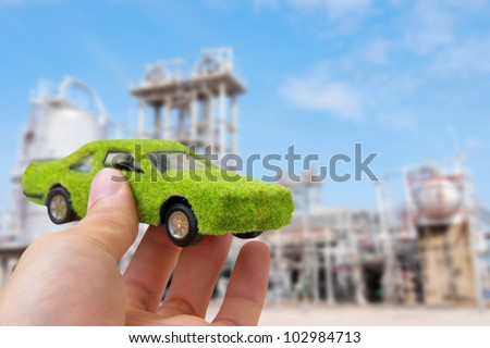 Hand Holding Eco car icon ,save energy concept - stock photo