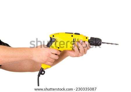 hand holding electric yellow drill tool close up isolated on white - stock photo