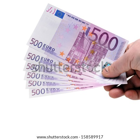 Hand holding Euro money fan - stock photo
