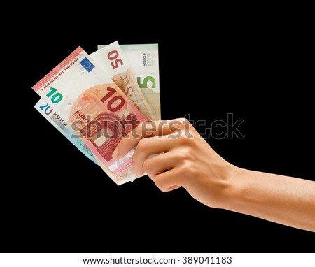 Hand holding euro money isolated on black background - stock photo