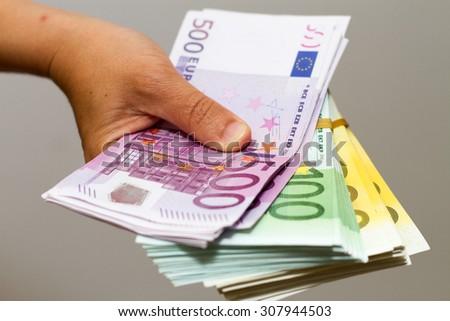 hand holding euro notes - stock photo