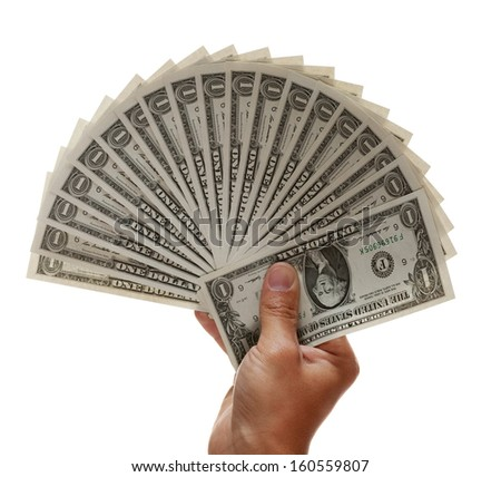 hand holding fan of crisp new dollar bills up - stock photo