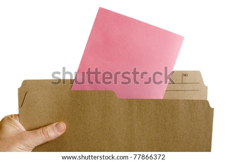 Hand holding file folder with Pink Slip Layoff Notice - stock photo