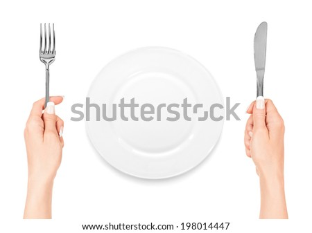 hand holding fork and knife with plate isolated on white background - stock photo