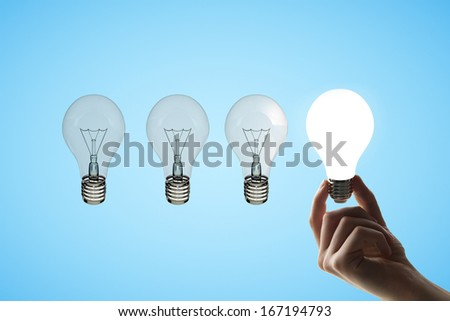 hand holding four lamps,  idea concept - stock photo