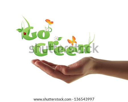 Hand holding Go Green text decorated with flowers,grass,water drops, ladybug and butterflies - stock photo