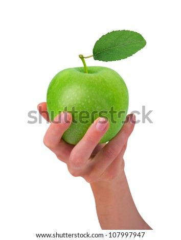 Hand holding green apple isolated on white - stock photo