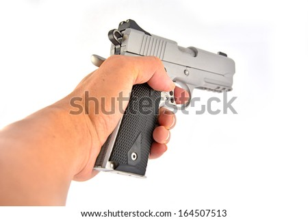 hand holding gun isolated on white background.  - stock photo
