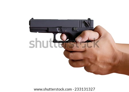 Hand holding gun on white background - stock photo
