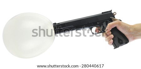 Hand holding gun with balloon isolated on white - stock photo