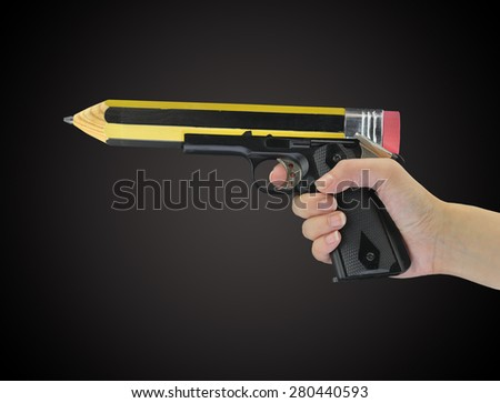 Hand holding gun with pencil point  - stock photo