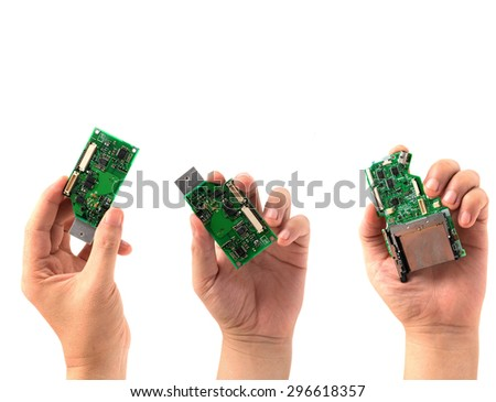 Hand holding IC chip isolated on white - stock photo