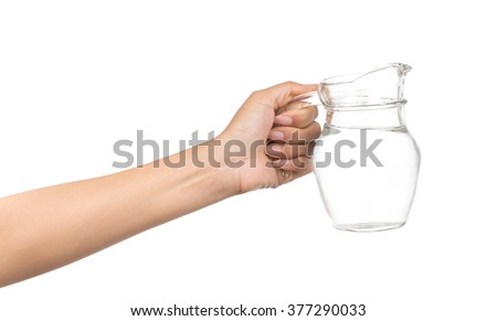 hand holding jug of water isolated on white background - stock photo