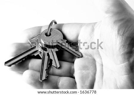 Hand holding keys - stock photo
