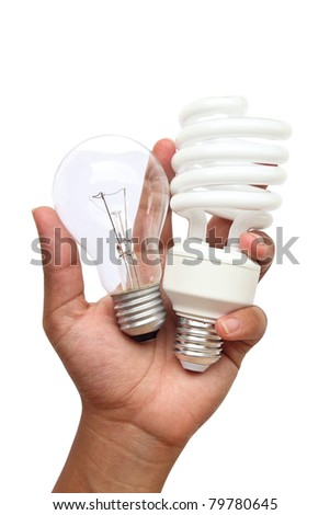hand holding lamp two type : Incandescent light and Fluorescent light. This image contain clipping path. - stock photo