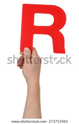 Hand holding letter R from alphabet isolated on a white background - stock photo