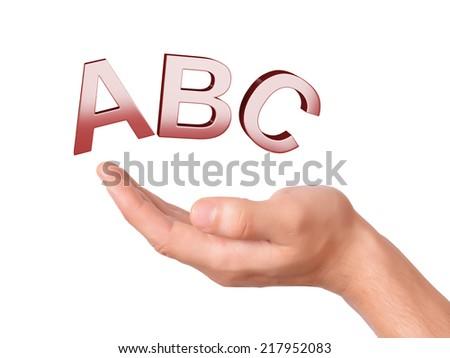 hand holding letters ABC symbol on white Background - stock photo