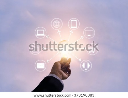 Hand holding light bulb network connection, Omni Channel or Multi channel  - stock photo