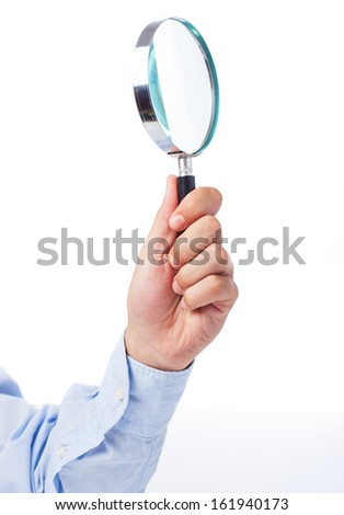 hand holding magnifying glass isolated on a white background - stock photo