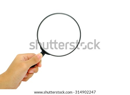 Hand holding magnifying glass on white background. - stock photo