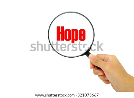 Hand holding magnifying glass with words hope. - stock photo