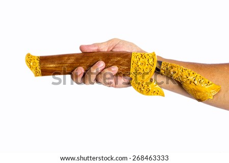 hand holding malay art knife - stock photo