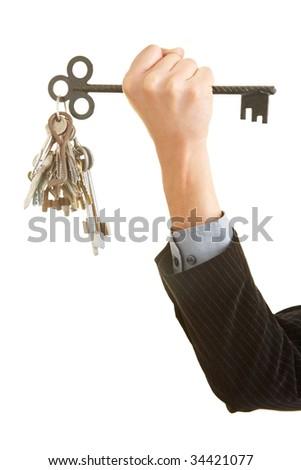 Hand holding many keys - stock photo