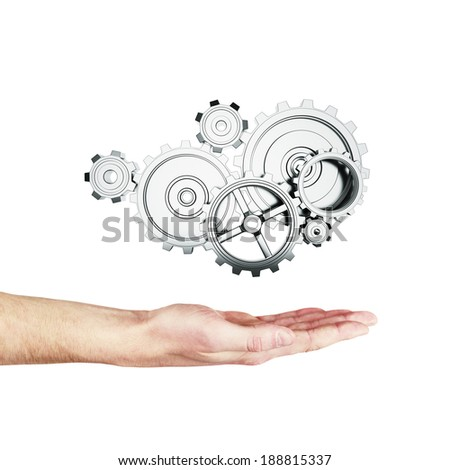 hand holding metal gears and cogwheels on white background - stock photo