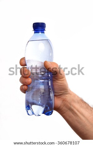 Hand holding mineral water bottle on white background. - stock photo