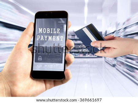 Hand holding mobile phone at supermarket digital wallet concept.  - stock photo