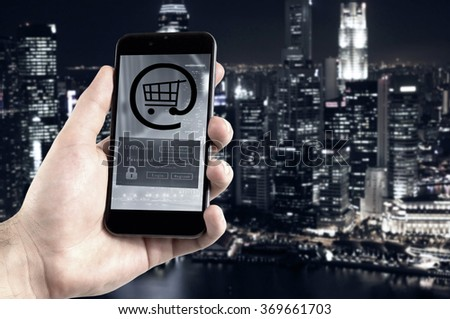 Hand holding mobile phone digital wallet concept.  - stock photo