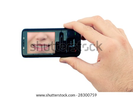 Hand holding mobile phone with smile on display - stock photo
