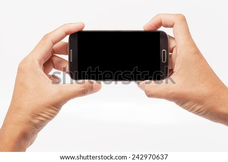 Hand holding mobile smart phone  on white background - stock photo
