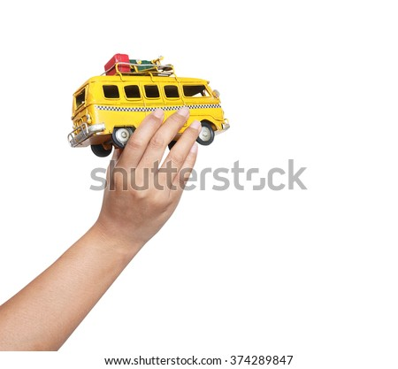 Hand holding model car, isolated on white background (travel concept) - stock photo