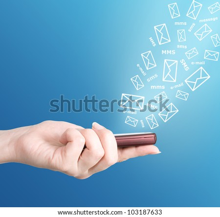 Hand holding modern mobile phone and letters flaying away. Social media concept - stock photo
