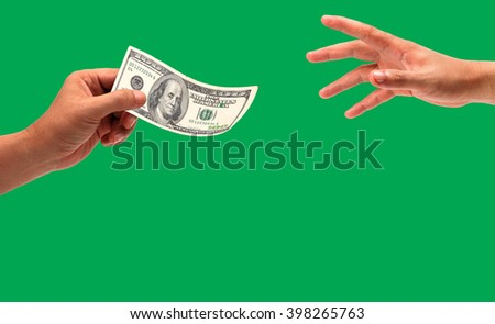 hand holding money dollars, 100 US dollar banknote on green background - stock photo