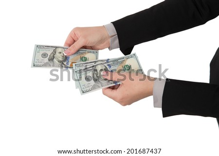 Hand holding money in dollars isolated on white background - stock photo
