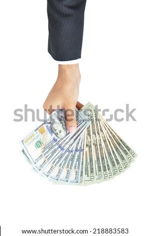 Hand holding money - United States dollar (USD) bills - stock photo